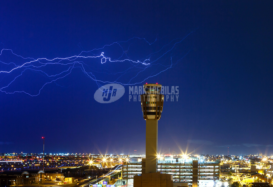 Jul 16, 2017; Phoenix, Arizona, USA; Lightning strikes above the air traffic control tower at the terminal at Sky Harbor International Airport. Mandatory Credit: Mark J. Rebilas