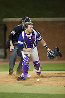 High Point Panthers catcher JJ Woodard (11) keeps his eye on the runner at first base as he chases after a wild pitch during game two of a double-header against the NJIT Highlanders at Williard Stadium on February 18, 2017 in High Point, North Carolina.  The Highlanders defeated the Panthers 4-2.  (Brian Westerholt/Four Seam Images)