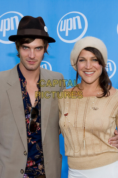LUCAS BRYANT & GUEST.UPN Summer Press Tour Party .Paramount Studios.Los Angeles, 21st July 2005.half length half-length hat beret cream jumper grey suit jacket pattern shirt.www.capitalpictures.com.sales@capitalpictures.com.© Capital Pictures.