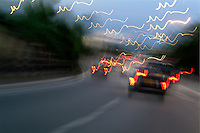 Cars moving on a highway as seen through a blurred windscreen, Paris, France.