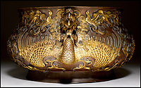 BNPS.co.uk (01202 558833)<br /> Pic: KollerAuctions/BNPS<br /> <br /> Gilded phoenix handles.<br /> <br /> Smashed It! - £3.8 million paid for 300 year old Chinese bronze used to keep tennis balls in.<br /> <br /> The incense burning censer, decorated with auspicious peony and phoenix designs, was thought by its owners to be a 19th century copy.<br /> <br /> It was only when the family invited Asian art specialist Regi Preiswerk to their home to look at some other antiques that its true potential was spotted.<br /> <br /> The 2ft wide urn weighing a hefty 48 lbs was made for a Qing Emperor in the 18th century.