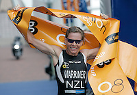 30 JUL 2006 - SALFORD, UK - Samantha Warriner (NZL) celebrates winning the Elite Womens race at the Salford ITU World Cup triathlon. (PHOTO (C) NIGEL FARROW)