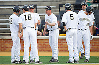 Wake Forest Demon Deacons assistant coach Bill Cilento (37) talks with some of his players during the game against the Maryland Terrapins at Wake Forest Baseball Park on April 4, 2014 in Winston-Salem, North Carolina.  The Demon Deacons defeated the Terrapins 6-4.  (Brian Westerholt/Four Seam Images)