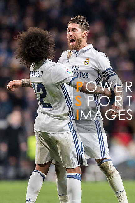 Marcelo Vieira Da Silva (l) of Real Madrid celebrates with teammate Sergio Ramos during their Copa del Rey 2016-17 Quarter-final match between Real Madrid and Celta de Vigo at the Santiago Bernabéu Stadium on 18 January 2017 in Madrid, Spain. Photo by Diego Gonzalez Souto / Power Sport Images