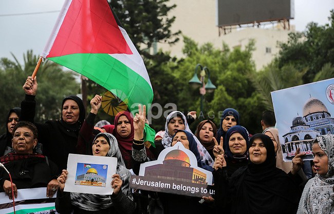 Palestinian women take part during a protest against U.S. President Donald Trump's decision to recognise Jerusalem as the capital of Israel, in Gaza City December 24, 2017. Photo by Mohammed Dahman