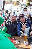 AUSTRIA, St. Anton am Arlberg, Friends share a beer at the Mooserwirt Apres Ski Bar