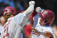 NWA Democrat-Gazette/CHARLIE KAIJO South Carolina infielder LT Tolbert (11) and infielder Justin Row (3) react after a score during the second game of the NCAA super regional baseball, Sunday, June 10, 2018 at Baum Stadium in Fayetteville. Arkansas fell to South Carolina 5-8.