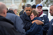 United States President Barack Obama hugs Donna Vanzant, the owner of North Point Marina, as he tours damage from Hurricane Sandy in Brigantine, New Jersey, Wednesday, October 31, 2012. .Mandatory Credit: Pete Souza - White House via CNP