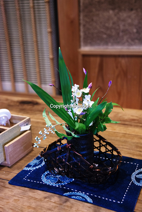 MAY 15, 2014 - KOJIMA, KURASHIKI, JAPAN: Flower on a Denim cloth at a Udon nudle restaurant .  (Photograph / Ko Sasaki)
