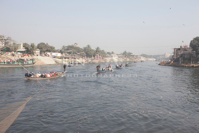 Bangladeshi Muslim devotees return home in an over-crowded boat after the World Congregation of Muslims, or Biswa Ijtema, on the outskirts of  Dhaka, Bangladesh. Jan 11, 2015
