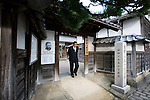 Photo shows the Lafcadio Hearn museum in Matsue, Shimane Prefecture, Japan on 05 Nov. 2012. Photographer: Robert Gilhooly.A visitor exits Lafcadio Hearn's old residence in Matsue, Shimane Prefecture, Japan on 05 Nov. 2012. Photographer: Robert Gilhooly.