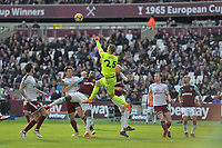 W25` punches clear a cross during West Ham United vs Burnley, Premier League Football at The London Stadium on 10th March 2018