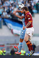 Calcio, finale di Coppa Italia: Roma vs Lazio. Roma, stadio Olimpico, 26 maggio 2013..Lazio forward Miroslav Klose, of Germany, partially hidden, and AS Roma midfielder Daniele De Rossi, right, jump for the ball during the Italian Cup football final match between AS Roma and Lazio at Rome's Olympic stadium, 26 May 2013..UPDATE IMAGES PRESS/Isabella Bonotto....