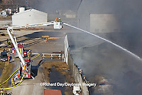63818-02315Firefighters extinguishing warehouse fire using aerial ladder truck viewed from top of ladder, Salem, IL