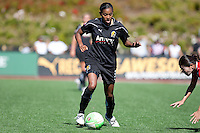 Candace Chapman (left) controls the ball against Homare Sawa (right). FC Gold Pride defeated the Washington Freedom 3-2 at Pioneer Stadium in Hayward, California on July 11th, 2010.
