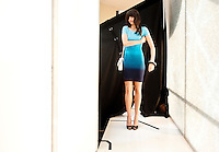 A model makes final adjustments to her clothing before walking out during the Macy's Runway Fashion Show at La Plaza Mall in McAllen, Texas, Saturday, April 3, 2010. Stores within the La Plaza Mall have done well throughout the economic crisis due to its proximity to Mexico and the influx of Mexican tourists who purchase goods to bring back home. ...PHOTO/ Matt Nager