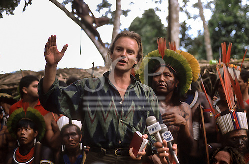 Altamira, Para State, Brazil. Sting, the singer, surrounded by Indians. Altamira Gathering, 1989.