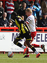 Clayton Donaldson of Brentford and Mark Roberts of Stevenage tussle. - Stevenage v Brentford - npower League 1 - Lamex Stadium, Stevenage - 21st April, 2012. © Kevin Coleman 2012