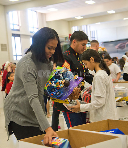 Washington, DC,December 7, 2016, USA:  First Lady Michelle Obama visits Joint Base Anacostia-Bolling  where she helps with the distribution of toy and gifts donated by the executive office of the presidential staff to the Marine Corps Reserver Toys for Tots program. Patsy Lynch/MediaPunch