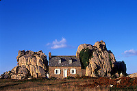 Le Gouffre, modest country cottege nestled between two huge boulders and looking out to the ocean.
