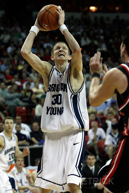 Las Vegas, Nevada --3/14/08--.BYU's Lee Cummard, #30, grabs a rebound during the second half of the game at the Thomas & Mack Center.  BYU won 63-54...************.Mountain West Conference basketball Tournament. .Photo by Chris Detrick/The Salt Lake Tribune..