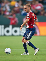 CARSON, CA – July 2, 2011: Chivas USA midfielder Simon Elliott (9) during the match between Chivas USA and Chicago Fire at the Home Depot Center in Carson, California. Final score Chivas USA 1, Chicago Fire 1.