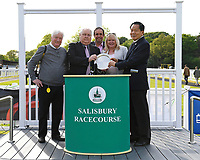 Connections of Beyond Equal receive their trophy from sponsors after winning The Penang Turf Club Malaysia Handicap (Class 5)   during Afternoon Racing at Salisbury Racecourse on 17th May 2018