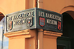 Close up of sign for the Hanseatic museum Bryggen area, city of Bergen, Norway UNESCO World Cultural Heritage site