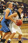SIOUX FALLS, SD - DECEMBER 5:  Alison Klostergaard #52 from the University of Sioux Falls looks to make a move against Upper Iowa in the second half of their game Friday night at the Stewart Center.  (Photo by Dave Eggen/inertia)