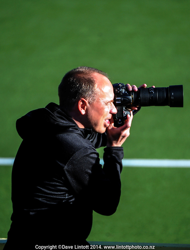 A photographer shoots the international women's hockey match between the NZ Black Sticks and Australia Hockeyroos at National Hockey Stadium, Wellington, New Zealand on Tuesday, 18 November 2014. Photo: Dave Lintott / lintottphoto.co.nz