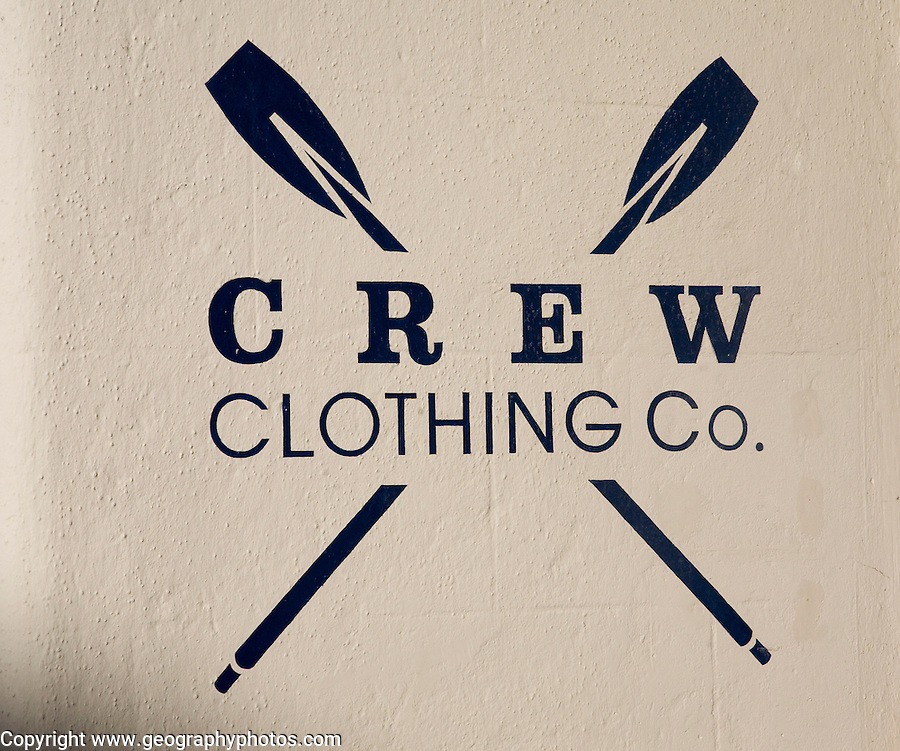 Stencil painted sign on wall for Crew Clothing Co, UK