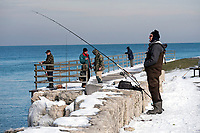 Andy Boychuk, of Camlachie fishing for rainbow trout, along with about a dozen other fishermen who lined the bank of the St. Clair River and Lake Huron.