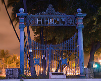 H & Co. Ltd. wrought iron gate at night, Honolulu, Oahu, Hawaii