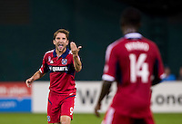 Mike Magee (9) of the Chicago Fire yells to his teammate, Patrick Nyarko (14) during a Major League Soccer game at RFK Stadium in Washington, DC.  The Chicago Fire defeated D.C. United, 3-0.