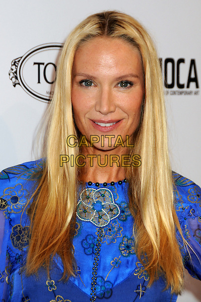 KELLY LYNCH .TOD's Beverly Hills Boutique Launch Celebration held at TOD's Boutique, Beverly Hills, California, USA, .15th April 2010..portrait headshot  blue purple print gold patterned beaded smiling .CAP/ADM/BP.©Byron Purvis/AdMedia/Capital Pictures.