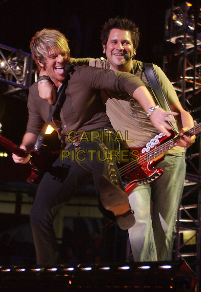 JOE DON ROONEY & JAY DeMARCUS OF RASCAL FLATTS.2007 CMA Music Festival held at LP Field,Nashville, Tennessee, USA, 09  June 2007..full 3/4 length live on stage concert country performing band.CAP/ADM/LF.©Laura Farr/AdMedia/Capital Pictures.