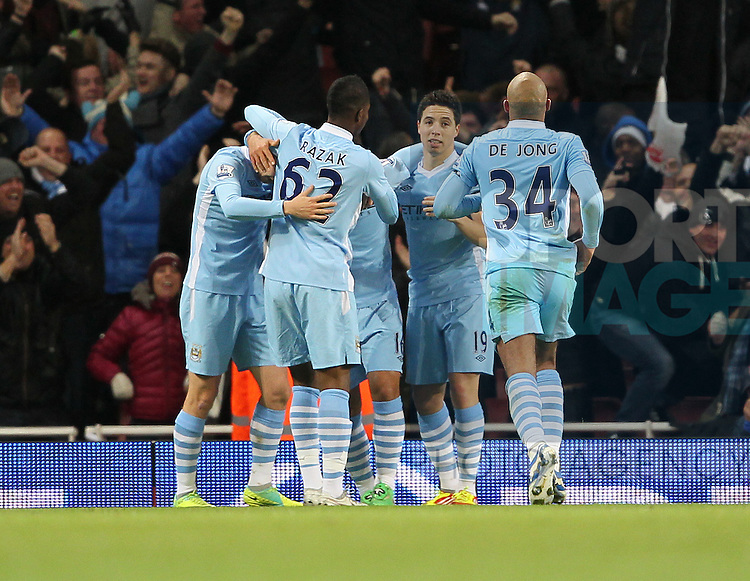 Manchester Citys Sergio Aguero celebrates scoring his sides opening goal with Samir Nasri