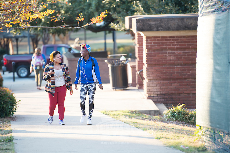 Students walking next to YMCA Building.<br />  (photo by Megan Bean / &copy; Mississippi State University)