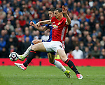 Gary Cahill of Chelsea in action with Zlatan Ibrahimovic of Manchester United during the English Premier League match at Old Trafford Stadium, Manchester. Picture date: April 16th 2017. Pic credit should read: Simon Bellis/Sportimage