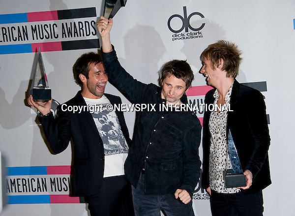"MUSE_with their Awards.American Music Awards 2010,Nokia Rheatre, Los Angeles_21/10/2010.Mandatory Photo Credit: ©Dias/Newspix International..**ALL FEES PAYABLE TO: ""NEWSPIX INTERNATIONAL""**..PHOTO CREDIT MANDATORY!!: NEWSPIX INTERNATIONAL(Failure to credit will incur a surcharge of 100% of reproduction fees)..IMMEDIATE CONFIRMATION OF USAGE REQUIRED:.Newspix International, 31 Chinnery Hill, Bishop's Stortford, ENGLAND CM23 3PS.Tel:+441279 324672  ; Fax: +441279656877.Mobile:  0777568 1153.e-mail: info@newspixinternational.co.uk"