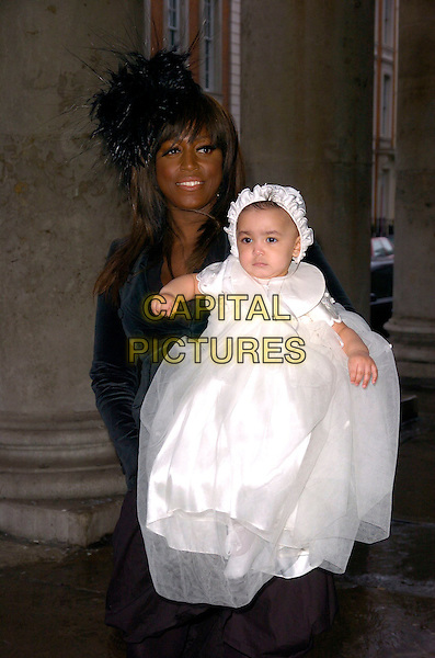MICA PARIS & baby RUSSIA MAE.At the christening of baby Russia Mae,.St. George's Church, London, England, .March 18th 2007..half length white bonnet hat dress black feather mother mum family daughter.CAP/CAN.©Can Nguyen/Capital Pictures