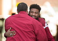Hawgs Illustrated/BEN GOFF <br /> Bret Bielema, Arkansas head coach, hugs wide receiver Jared Cornelius during recognition of senior players before the game against Missouri Friday, Nov. 24, 2017, at Reynolds Razorback Stadium in Fayetteville.