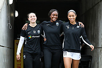 CARY, NC - OCTOBER 20: Morgan Andrews #12, Ifeoma Onumonu #25, and Darian Jenkins #11 of Reign FC enter the field during a game between Reign FC and North Carolina Courage at Sahlen's Stadium at WakeMed Soccer Park on October 20, 2019 in Cary, North Carolina.
