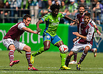 Seattle Sounders' Obafemi Martins, center, controls the ball against Colorado Rapids' Shane O'Niell (27) and Nathan Sturgis (24) during an MLS match on April 26, 2014 in Seattle, Washington.  Martins scored a goal  in the Seattle Sounders 4-1 win over the Colorado Rapids.  Jim Bryant Photo. ©2014. All Rights Reserved.
