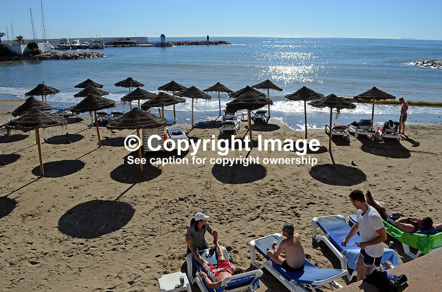 Paseo Maritimo, promenade, esplanade, seafront, beach, bathers, sunbathers, Marbella, Spain, palms, restaurants, bars, 201211130903..Copyright Image from Victor Patterson, 54 Dorchester Park, Belfast, UK, BT9 6RJ..Tel: +44 28 9066 1296.Mob: +44 7802 353836.Voicemail +44 20 8816 7153.Skype: victorpattersonbelfast.Email: victorpatterson@me.com.Email: victorpatterson@ireland.com (back-up)..IMPORTANT: If you wish to use this image or any other of my images please go to www.victorpatterson.com and click on the Terms & Conditions. Then contact me by email or phone with the reference number(s) of the image(s) concerned.