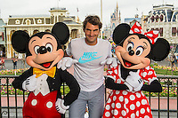 Roger Federer with  with Mickey and Minnie Mouse at the Magic Kingdom Park - Florida