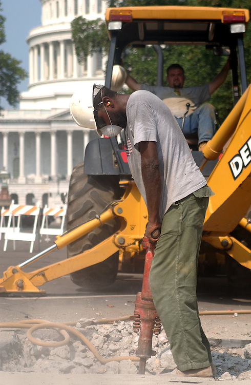 1construction080801 - Thomas Gary of Structural & Soil Systems, Inc., breaks concrete on the East Front of Capitol in order to uncover the water main to inspect it for future building of the Visitor Center.