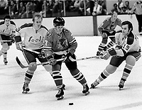 Seals  Stan Gilbertson and Bert Marshall check Chicago Blackhawks #??(1971 photo/Ron Riesterer)