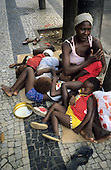 Rio de Janeiro, Brazil. Woman with five children begging on the street.