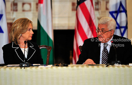 "United States Secretary of State Hillary Rodham Clinton listens as President Mahmoud Abbas of the Palestinian Authority makes remarks at the ""Relaunch of Direct Negotiations Between the Israelis and Palestinians"" in the Benjamin Franklin Room of the U.S. Department of State on Thursday, September 2, 2010.  .Credit: Ron Sachs / CNP.(RESTRICTION: NO New York or New Jersey Newspapers or newspapers within a 75 mile radius of New York City)"